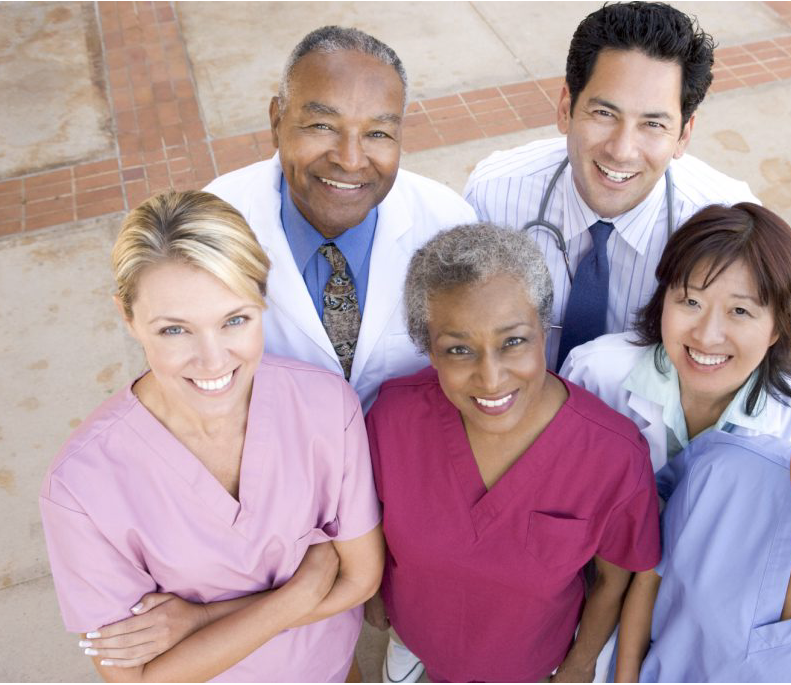 Group of medical professionals looks up at camera
