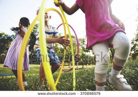 Children playing with hula hoops